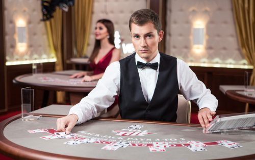 Blackjack dealer at a live casino table