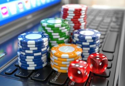 Casino chips and dices on a laptop