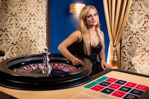 Female Casino Dealer and Roulette Wheel